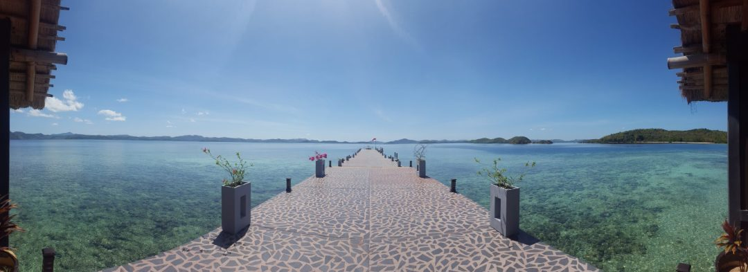 Panorama of jetty and turquoise sea from Huma Island reception in the Philippines
