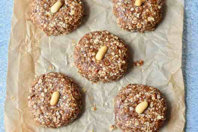 5 no-bake oatmeal raisin cookies on parchment paper