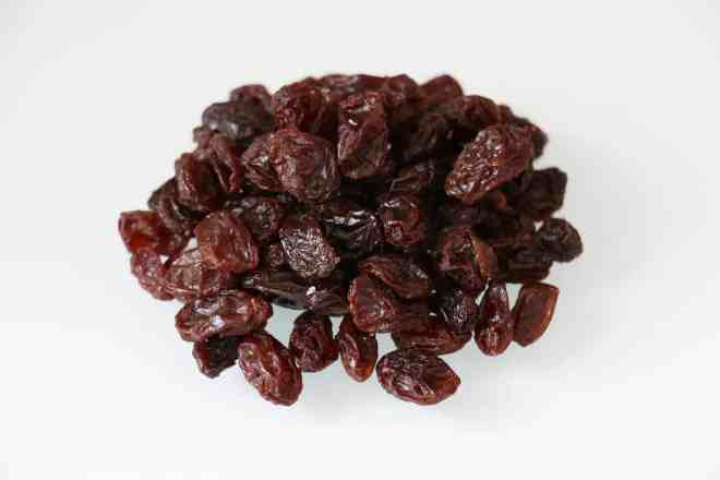 plain raisins on a white background