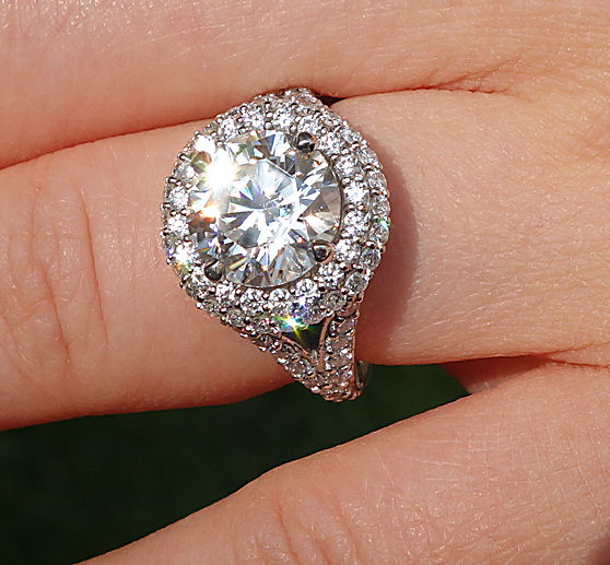 Amora Gem 9mm in Timeless Eclipse Halo - outdoors in sun, ring is platinum and size 4.25.