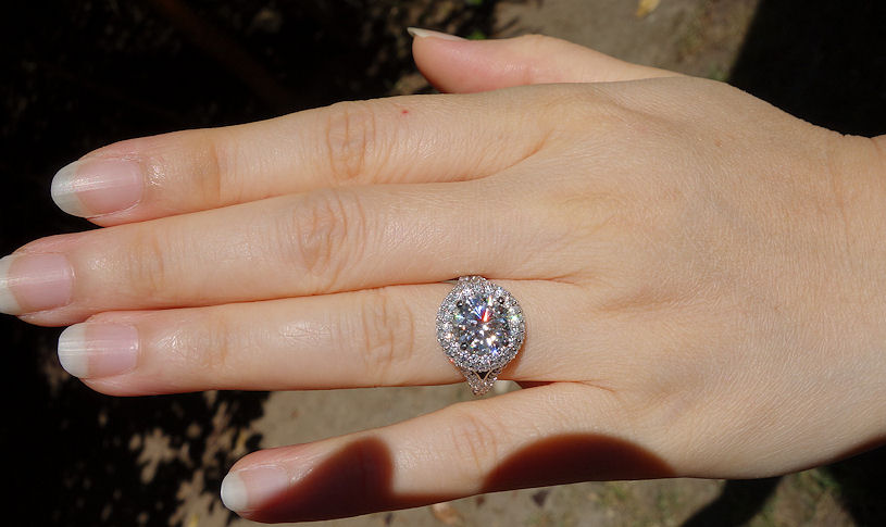 9mm Amora GEM in Timeless Eclipse ring - outdoors with sun, ring is platinum and size 4.25