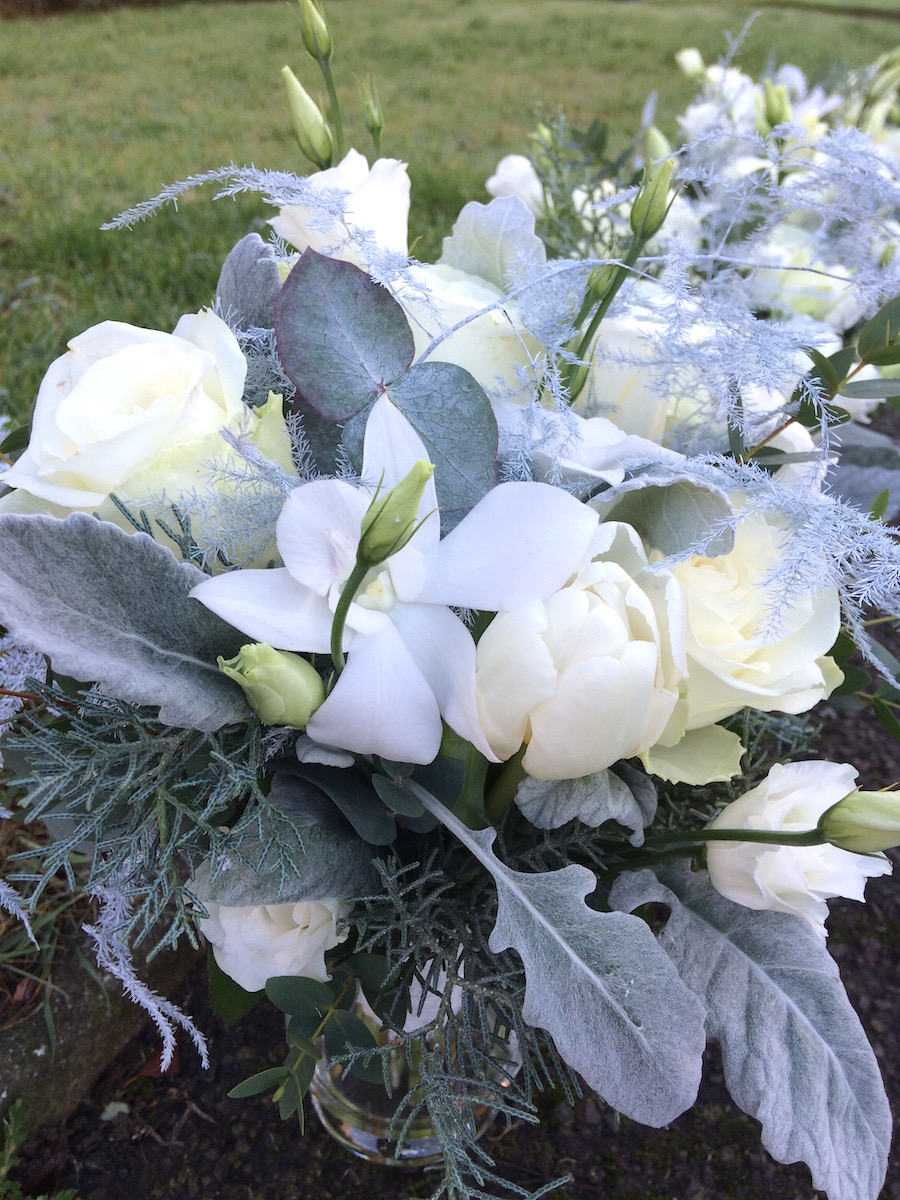 Winter Wedding Flowers  White  Silver table arrangements  Worthing