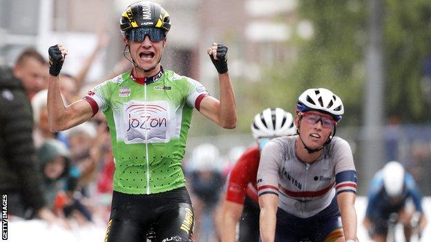 Vos (left) celebrates victory as she beat Barnes to the finishing line