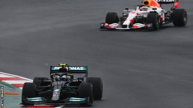 Mercedes driver Valtteri Bottas heads Red Bull's Max Verstappen