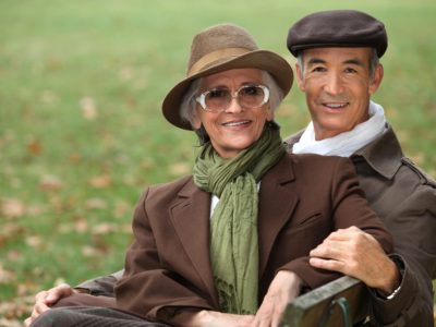 attractive senior couple on park bench