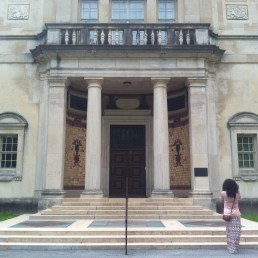 Emily is engulfed by the curves of the original gallery doors. Designed by Paul Cret with reliefs by Jacques Lipchitz.