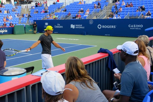 Le Chuck watching Nadal practice with the ladies.