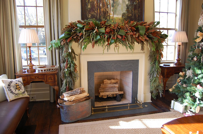 Christmas Mantel Decorated With Natural Greenery In