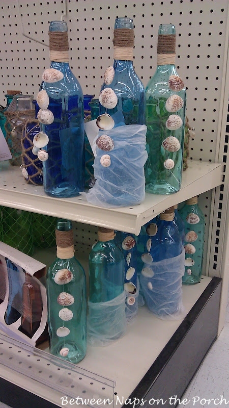 Shell Craft Decorate Bottles with Shells for a Beach Themed Decor