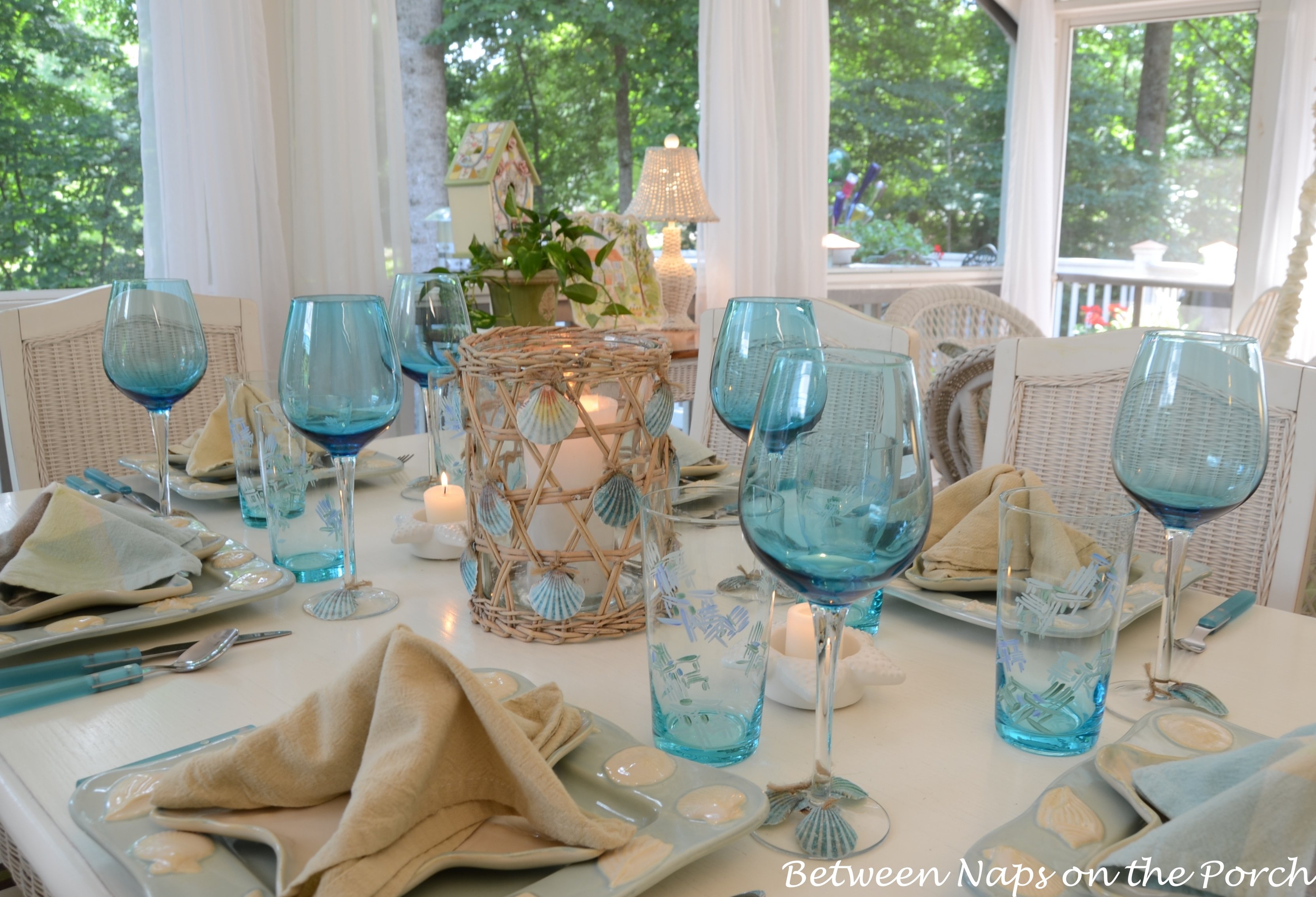 A Beach Themed Table Setting With A Starfish Napkin Fold