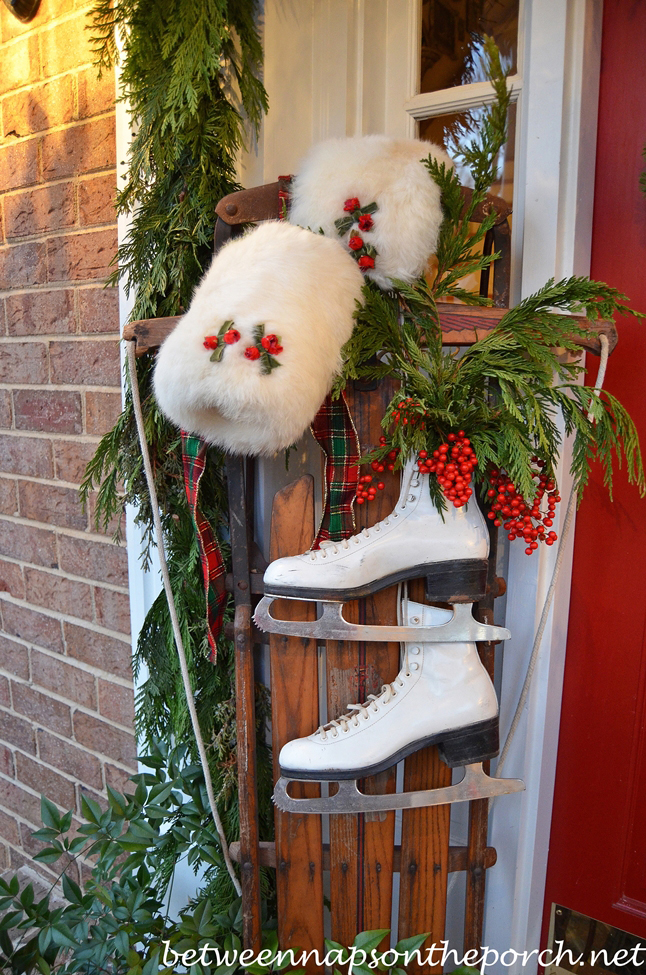 Decorating the Porch for Christmas with Natural Garland Sled Ice Skates and Snowflake Wreath