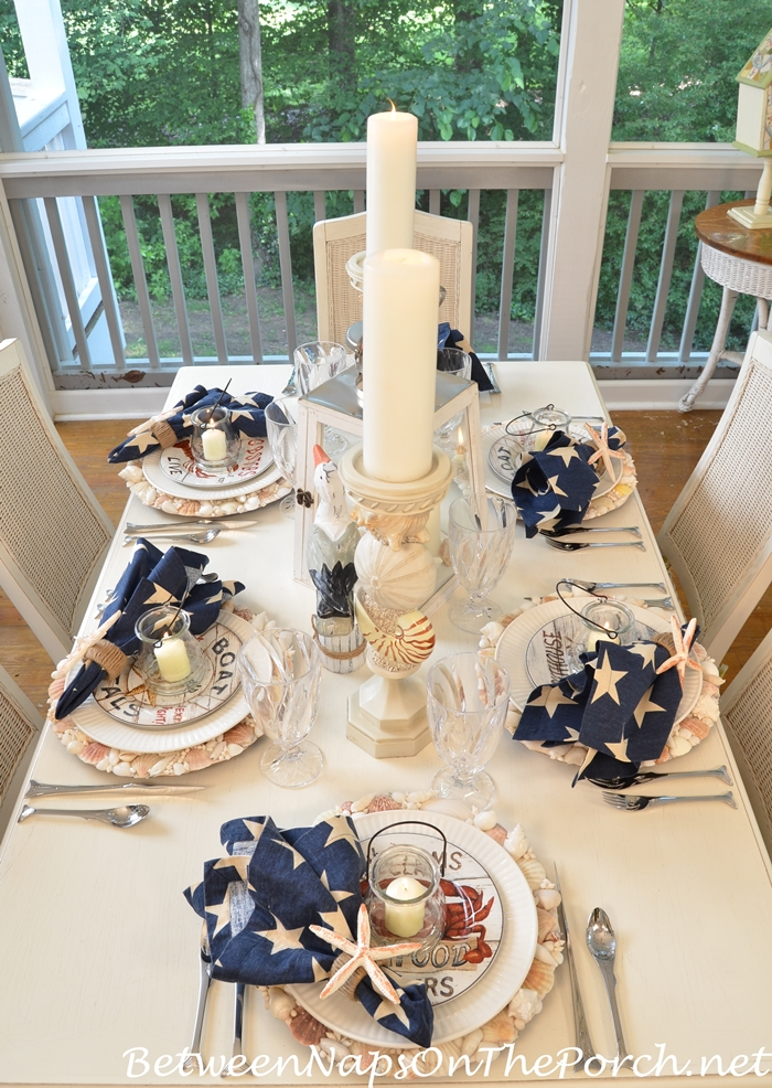 Nautical Tablescape With Shell Chargers And Fish Flatware