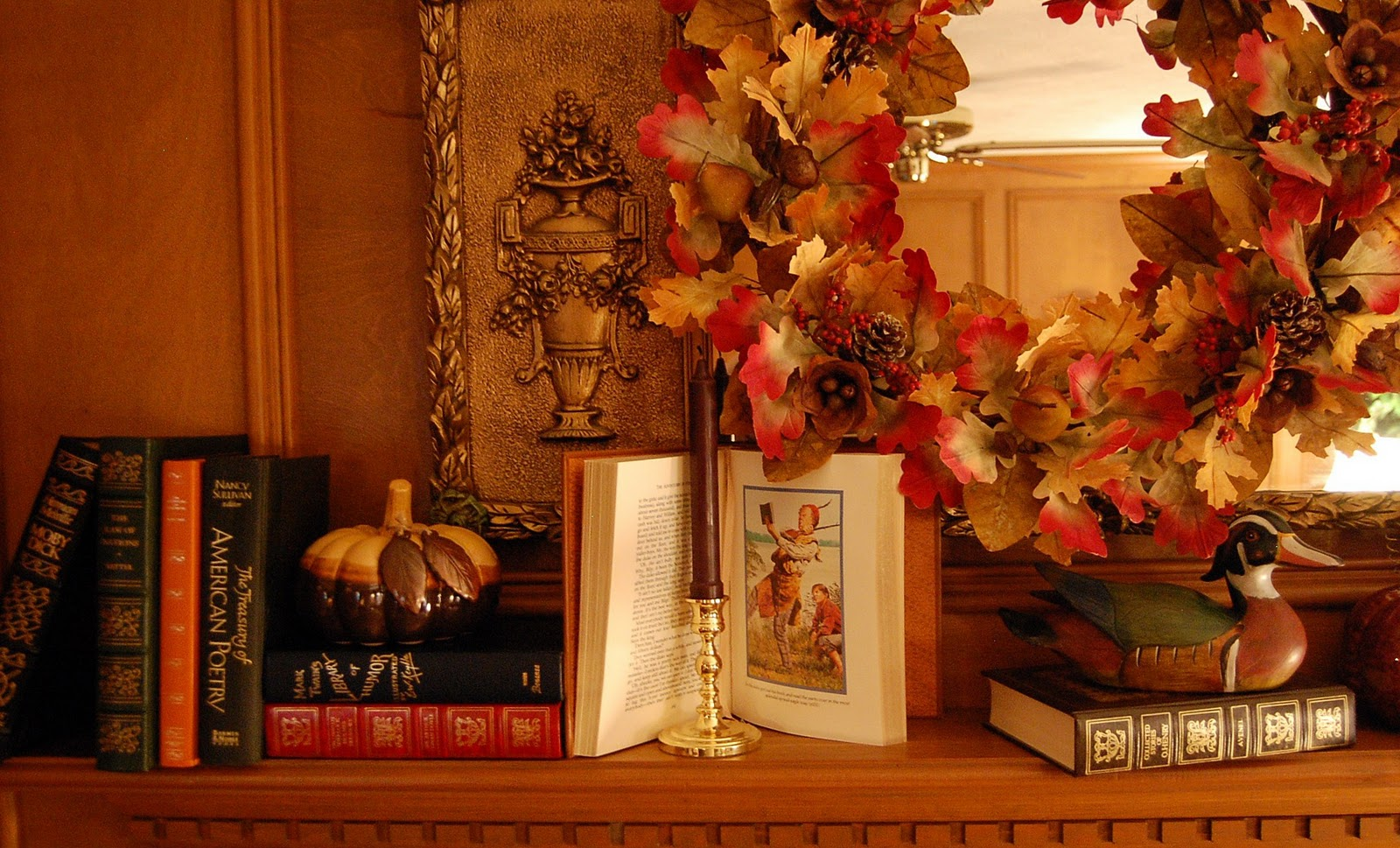Decorate a Fireplace Mantel for Fall or Autumn with Books Pumpkins and a Fall Wreath