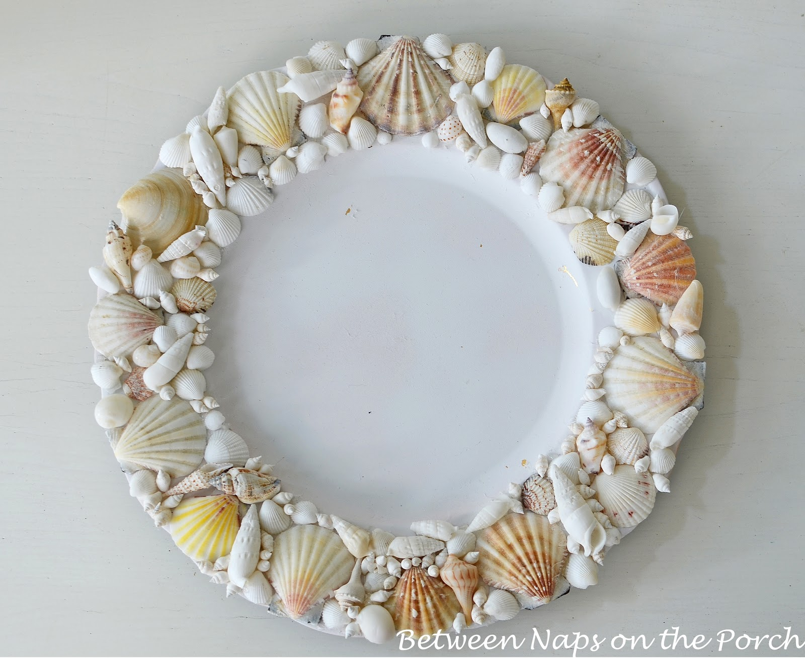 shell chair knock off tan office pottery barn chargers for a beach themed tablescape