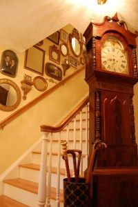 Decorate Staircases with Vintage Photos, Mirrors and Small