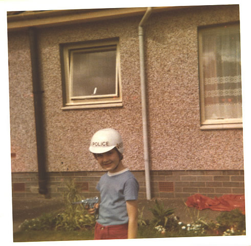 Me in the garden with my police helmet