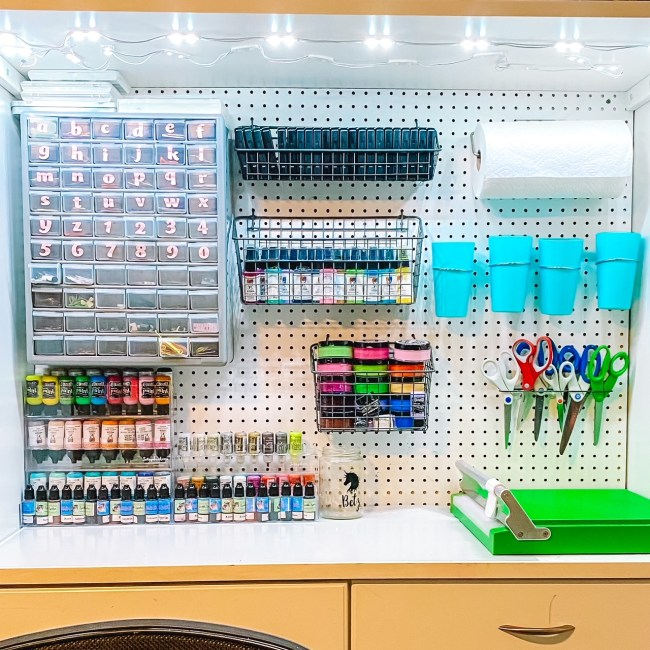 White Pegboard Craft Room Organization