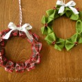 Original origami wreath ornament on right ribbon version on left