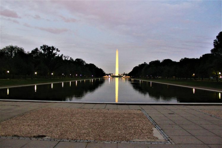 Washington Monument reflecting in the Lincoln Memorial Reflecting Pool, in Washington SC