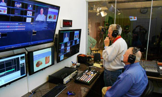 Al Torsey and Bob Stowe direct the Good Life show in the control room