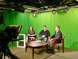 Stephanie and David Vanderbilt join host Jason Parisella on the set.