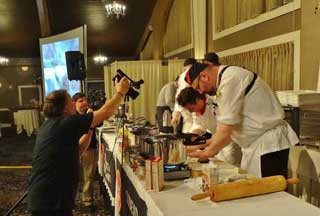 Volunteer Mark Layman zeroes in on the action during the Best Chef competition