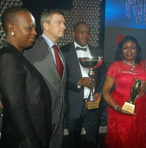 (L-R) Nigerian Breweries Plc, Managing Director' Wife, Clementine Vervelde, Managing Director, Nicolaas Vervelde, National Key Transporter Champion, Emmanuel Usiakpor of Joza Global Logistic and the National Champion of the Distributors Award 2015, Dem Joy Igwe , of Ifeoma Chukwuka Nigeria Limited at the Distributors' Award presentation