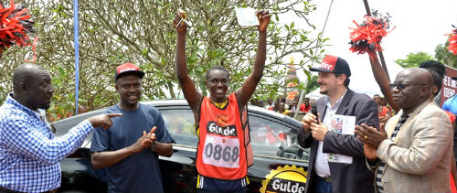 Emmanuel Agu, Marketing Manager, Gulder, More, 33, Life and Stout category, Nigerian Breweries Plc, Chinedu Ifezue, Franco Maria Maggi Marketing Director Nigerian Breweries Plc congratulating the winner of Gulder Ultimate Chase