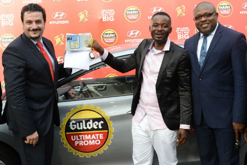 L- Marketing Director Nigerian Breweries Plc Franco Maria Maggi, presenting keys and vehicle documents to Francis Njoku, winner of a brand new Huyndai Elantra car at a raffle draw in the ongoing Gulder Ultimate Promo, with them is Kufre Ekanem, Corporate Affairs Adviser, also of Nigerian Breweries Plc at the presentation ceremony
