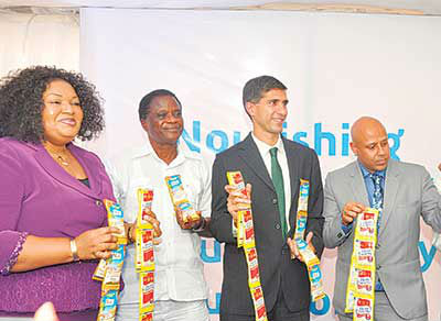 Corporate Affairs Director, FrieslandCampina WAMCO Nigeria PLC (FC WAMCO), Mrs. Ore Famurewa (left); Professor of Community Health Nutrition & Nutrition Consultant, Ladoke Akintola University of Technology (LAUTECH), Ogbomosho, Oyo State, Ebenezer Ojefitimi; Managing Director, FC WAMCO, Mr. Rahul Colaco; and Marketing Director, FC WAMCO, Mr. Tarang Gupta during the company's press launch of eight low unit product packs of Peak and Three Crowns milk on Tuesday in Lagos