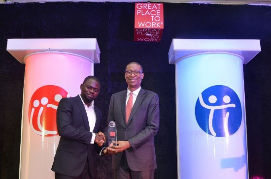 (L-R) Dr. Okechukwu Enyinna Enelamah, Minister for Trade and Investment presenting the top award for Excellence in Wellness to Guinness Nigeria and received by Asekunola Kuforiji, Head of Talent Engagement, Guinness Nigeria Plc, during the Great Place to Work awards held in Lagos recently