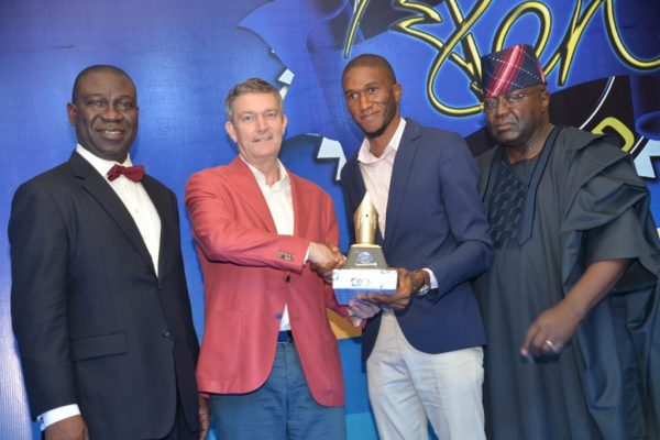 From Left to Right – Deputy Senate President, Ike Ekeremadu; Nicolaas Velverde, Managing Director, Nigerian Breweries; Tobi Aworinde, the Nigerian Breweries Golden Pen Reporter of the Year and Dr. Yemi Ogunbiyi, Chairman Panel of Judges, Nigerian Breweries Golden Pen Award at the Award night in Lagos