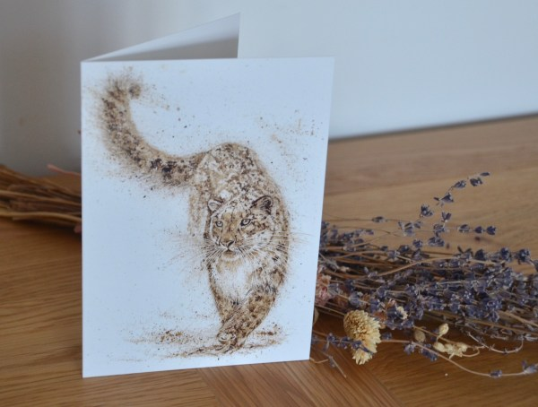 Snow leopard greetings card