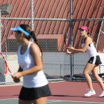 Junior Emily Dekhtyar gets ready to rally in a double match with her partner, junior Jenny Zatikian.