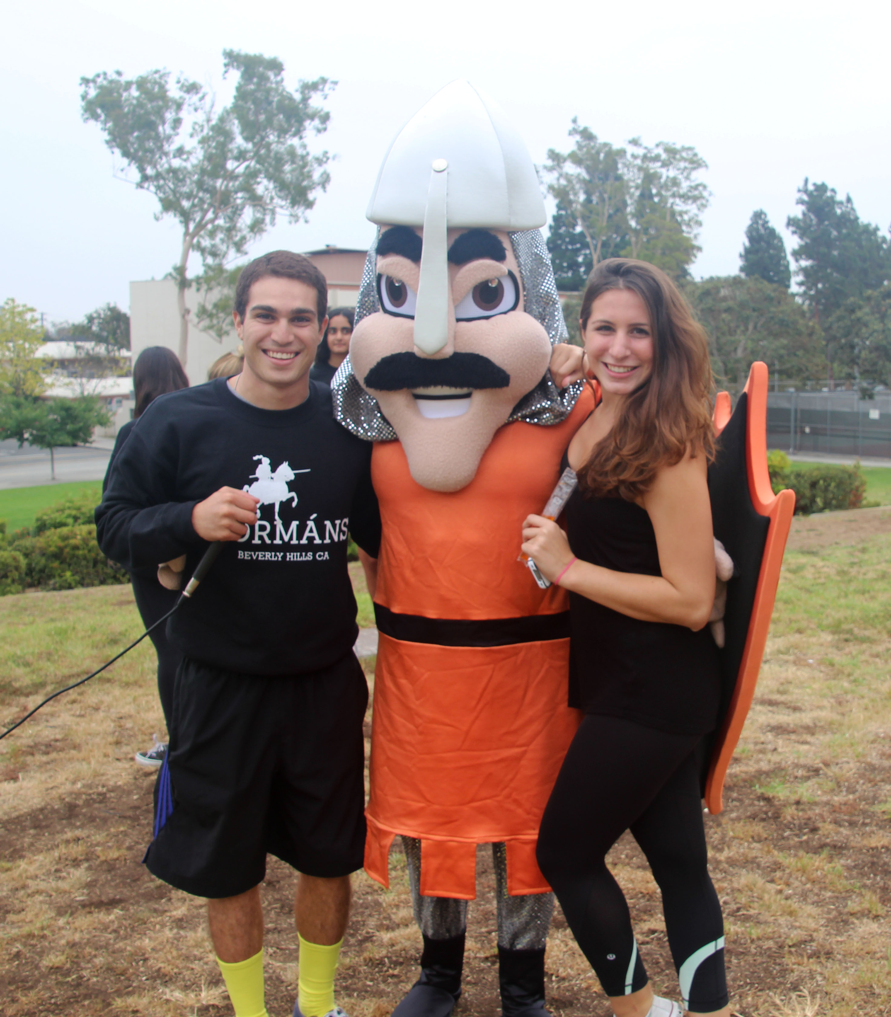 ASB members seniors Allie Kahn and Matt Mokhtarzadeh pose with the Norman mascot.