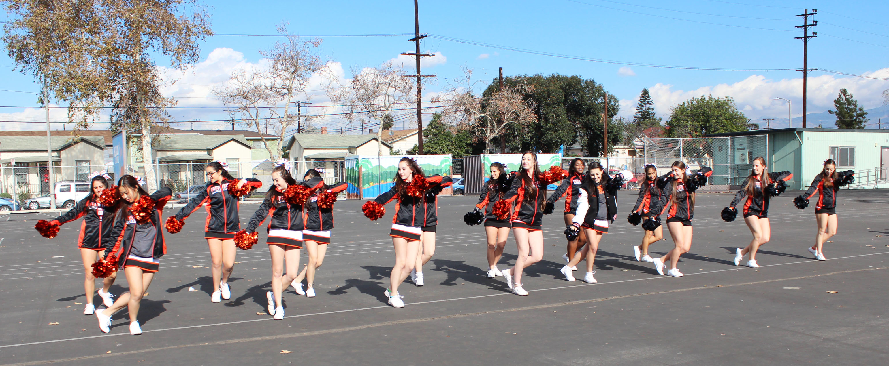 Cheer performs for Albion students during recess as part of the day's festivities.