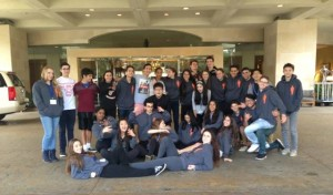 The members of DECA pose for a group picture in front of the Anaheim Marriot.