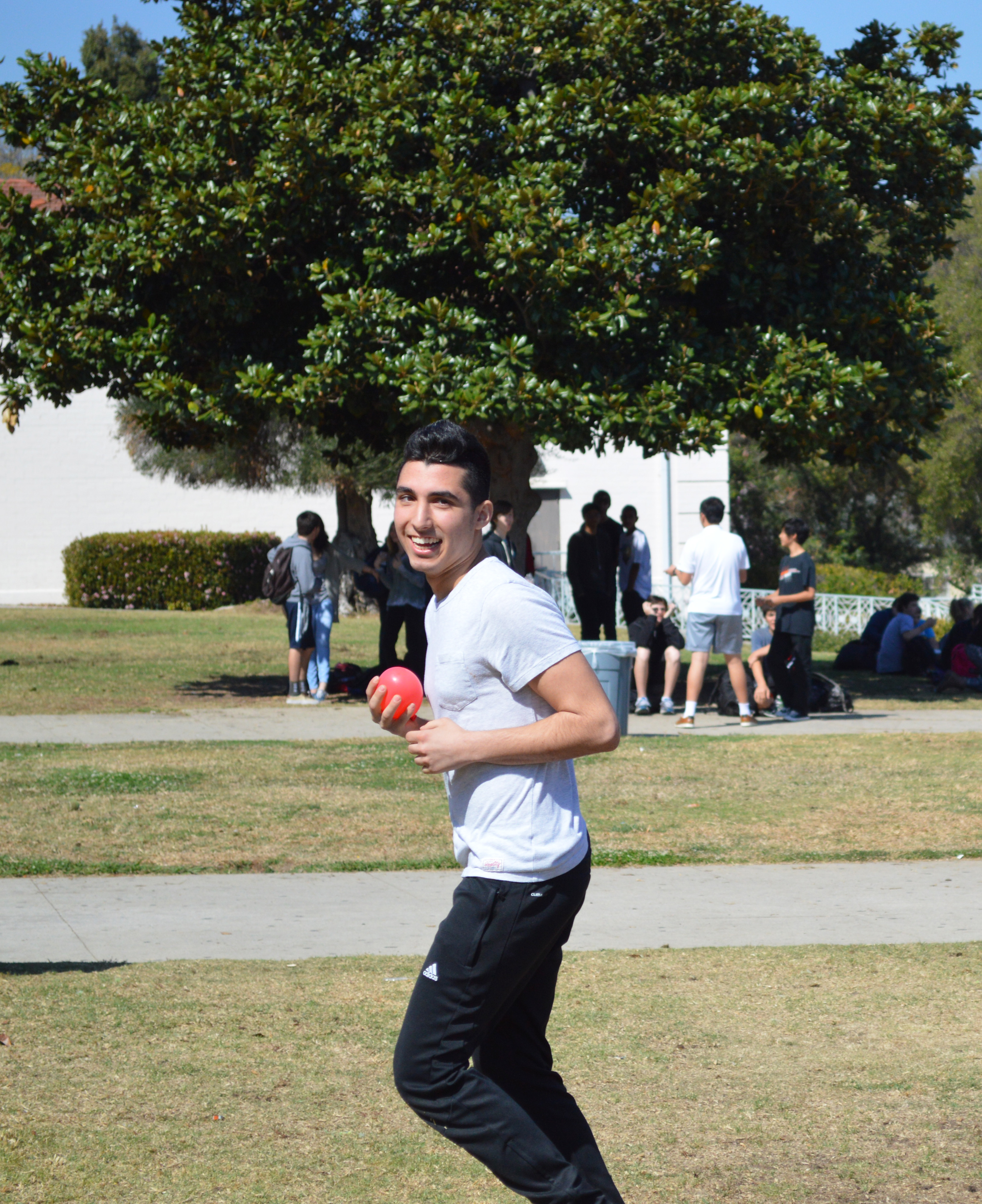 A participant of the water balloon toss prepares to throw the balloon to his partner during the final stages of the competition.