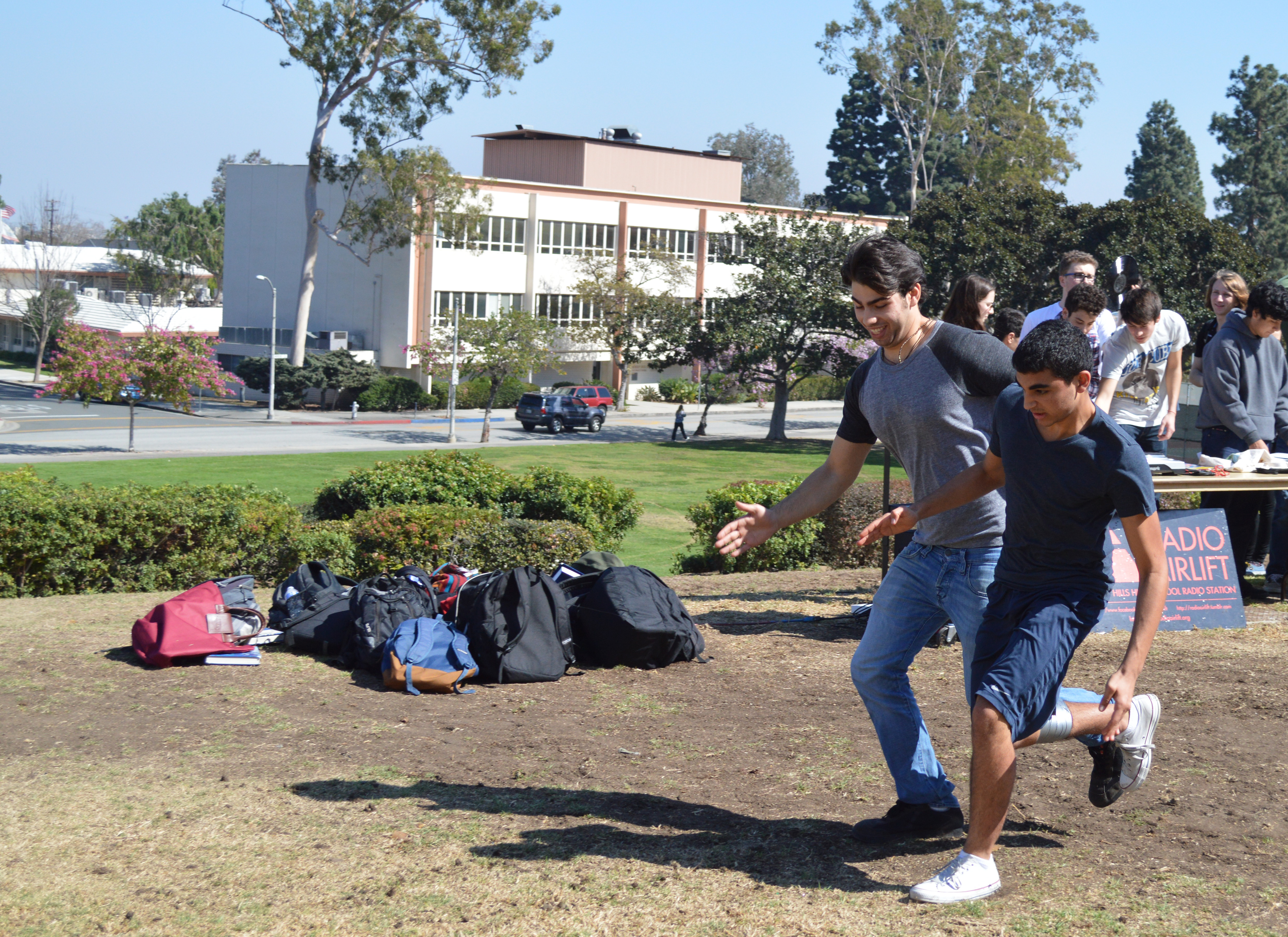 A pair of juniors race to the finish line of the three-legged race, coming in second place.