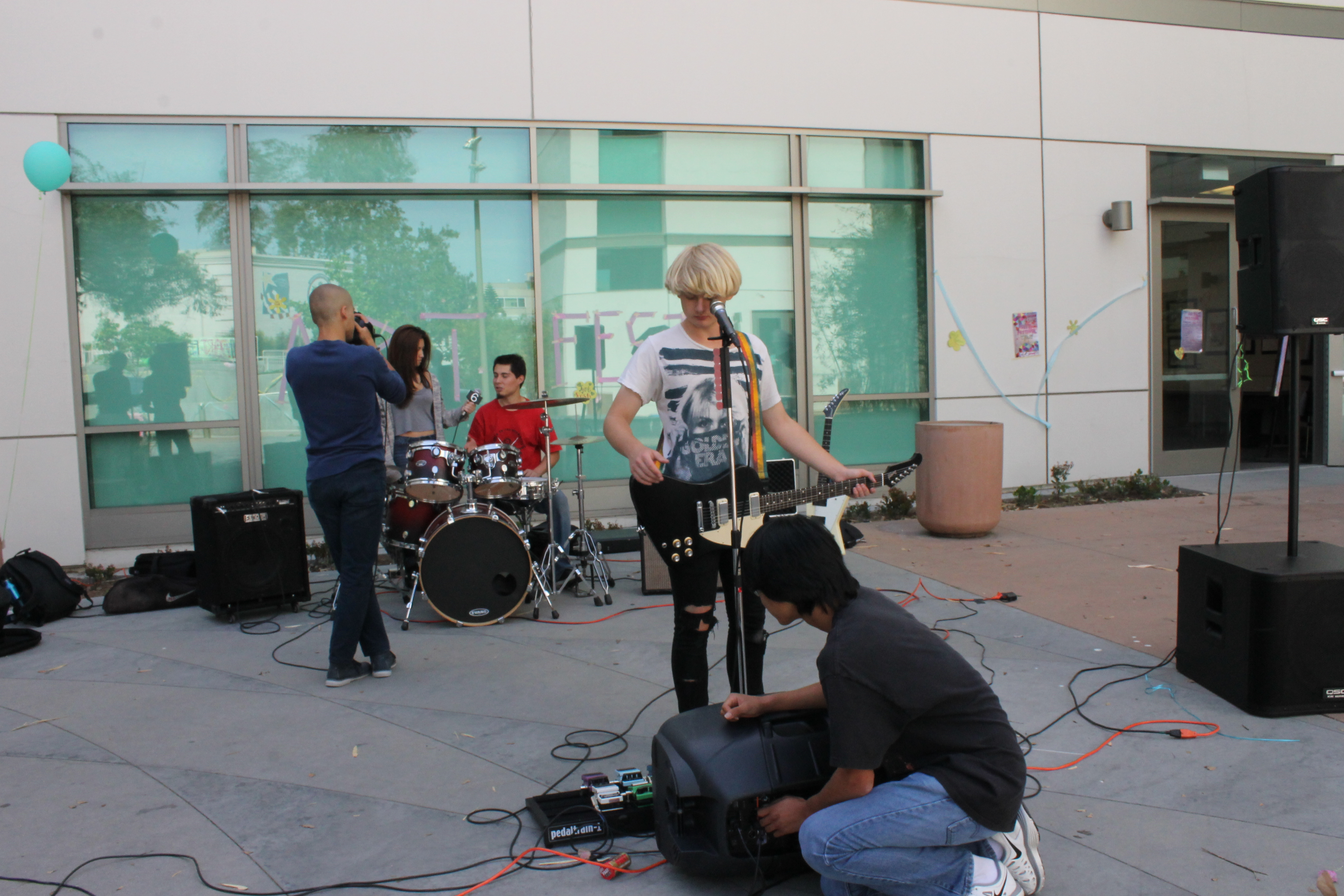 A student-run band performs a sound check in preparation for the event.