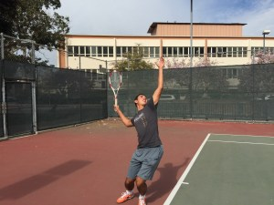 Junior Adriano Saitta goes into his serving motion. Photo by: LUCAS HARWARD