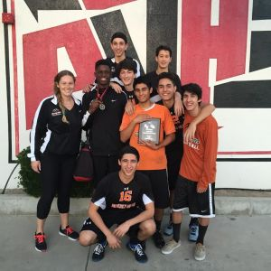 Boys varsity players and coach Sarah McCabe pose with their 2nd place plaque. Photo courtesy of: GUY GINSBERG