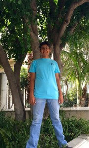 Alavy poses in his Operation U.S.A. ambassador's shirt. Photo courtesy of: SHAYAN ALAVY