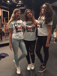 "Nikki Ovaisi, Isabella Lamas and Abbey Whelan pose in their ""Fear the Bow"" cheer spirit shirts. Photo by Sadie Hersh"