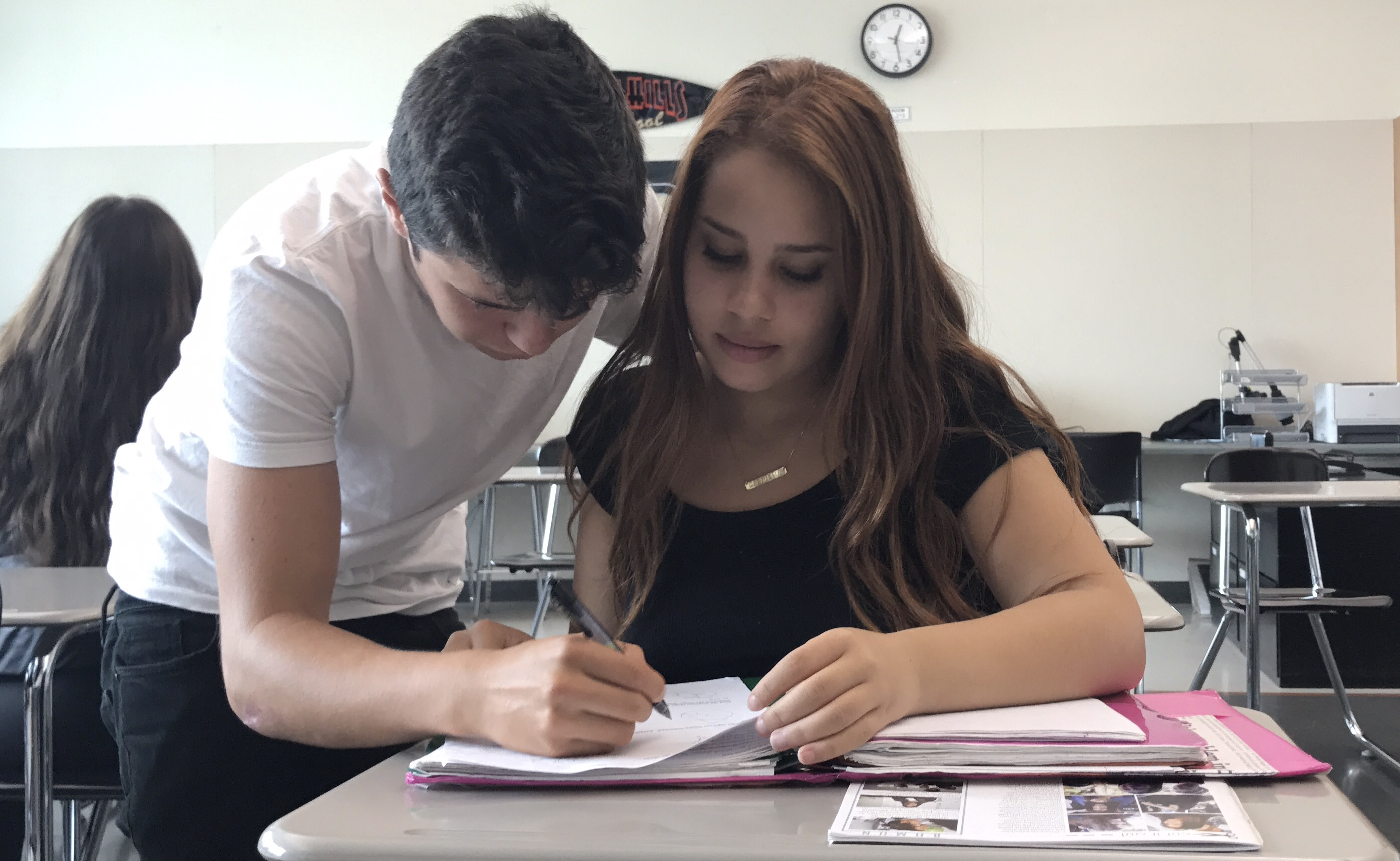 """In hopes of getting a good grade on their upcoming french final, sophomore Gabriella Johnson and sophomore Emiliano Valdez pair up to study. """"Coming from another country it definatly has been difficult to learn a new language, let alone two so I feel really blessed to have friends like Gabriella who help me and push me furthermore to succeed in challenging situations,"""" Valdez said."""