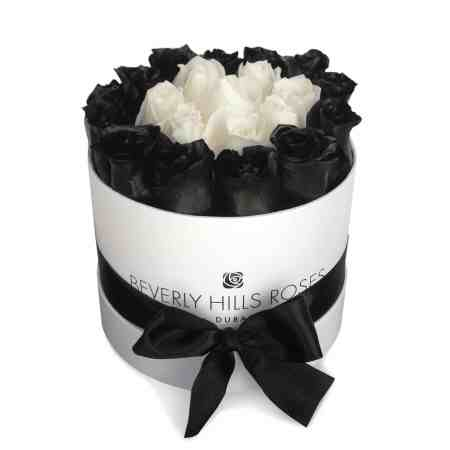 Small round white box in black & white