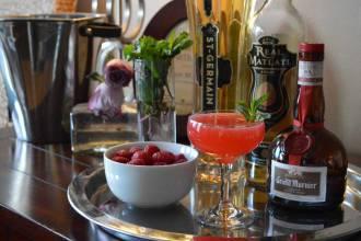 The Aventura Cocktail: Mezcal, Grand Marnier, St Germaine, Citrus, Raspberries, Mint