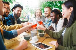 Diverse friends clinking glasses | Bevvy
