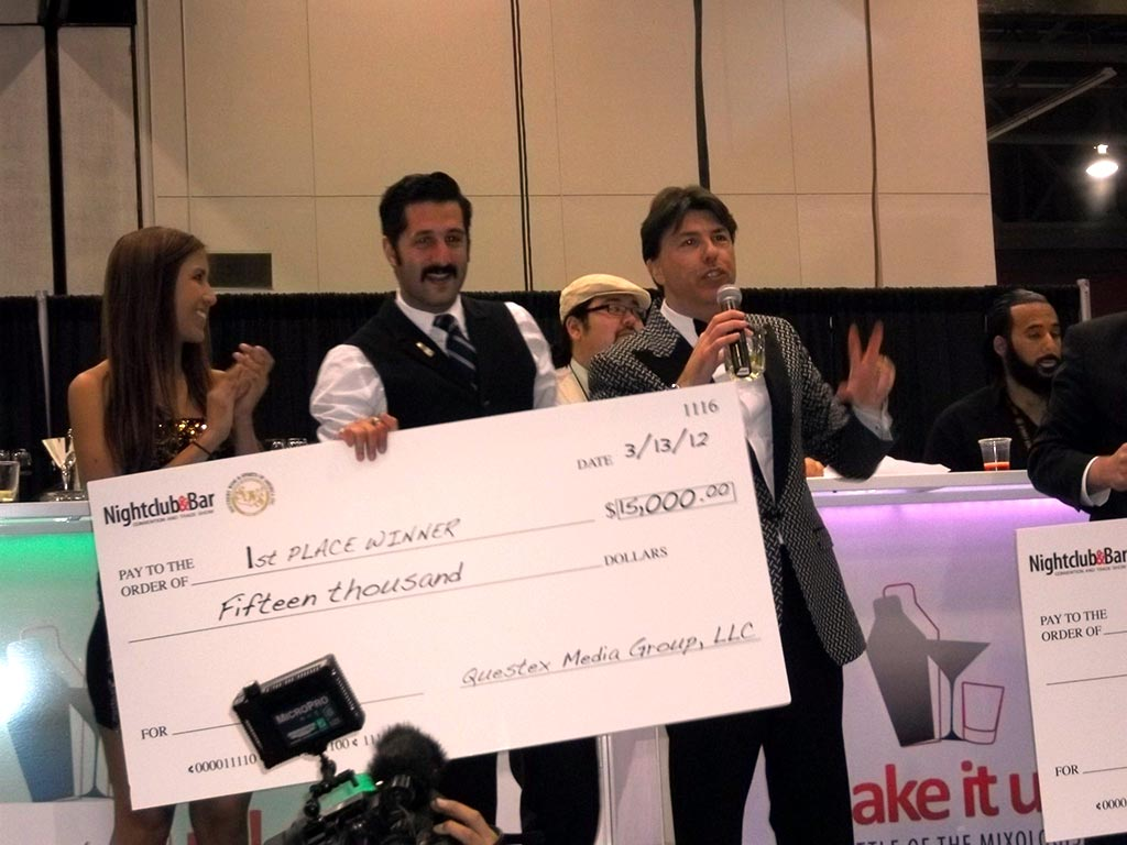 Josh Harris winning 1st place check of $15,000 at the 2012 Shake It Up! cocktail competition.