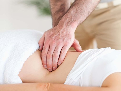 Woman receiving respiration massage